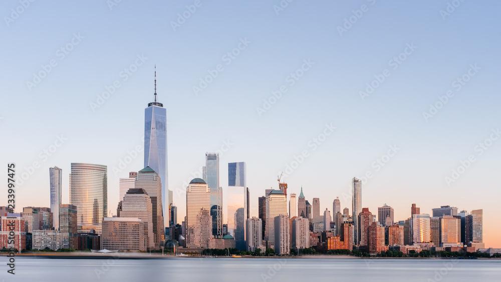 Fototapety, obrazy: Skyline of downtown Manhattan over Hudson River under blue sky, at sunset, in New York City, USA