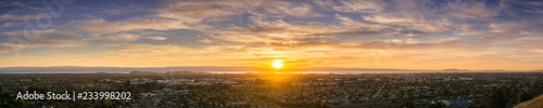 Expansive sunset panorama comprising the cities of east San Francisco bay, Fremont, Hayward and Union City, California
