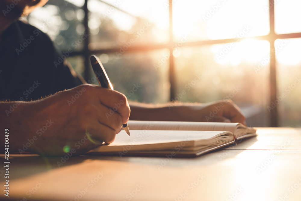 Fototapety, obrazy: Checklist Writing Notice Remember Planning Concept,home office desk background,hand holding pen and writing note on wood table.