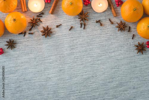 Fotografie, Tablou Christmas arrangement of holiday spices, oranges and candles