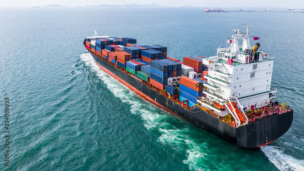 Fototapeta Aerial view cargo container ship sailing, container cargo ship in import export and business logistic and transportation of international by container ship, view from above business background.
