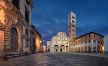Lucca, Italy. Panorama Of Piazza San Martino Square With Lucca Cathedral At Dusk