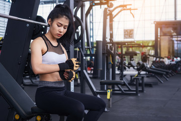 Woman exercise working out in fitness center gym. healthy lifestyle Concept .