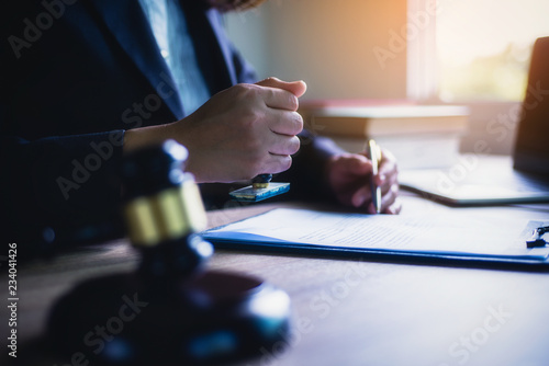 Canvas Print Business woman or lawyer sitting with hand holding stamp approve important contract in office