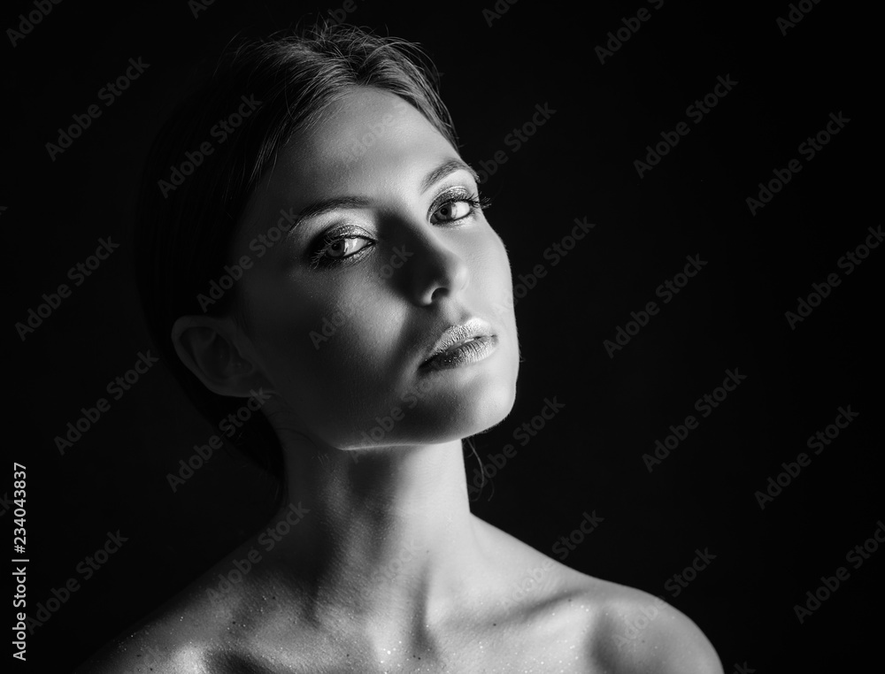 Fototapeta Black and white portrait of a beautiful young woman.