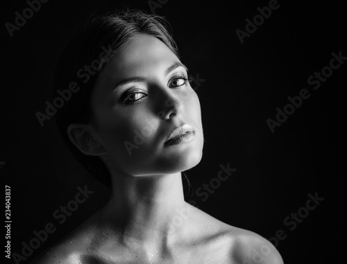Fotografie, Obraz  Black and white portrait of a beautiful young woman.