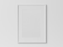 White Rectangular Vertical Frame Hanging On A White Wall Mockup 3D Rendering