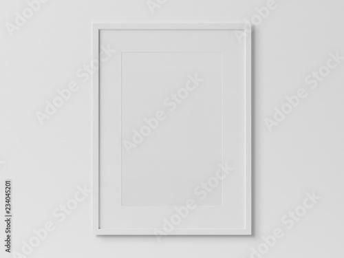 Obraz White rectangular vertical frame hanging on a white wall mockup 3D rendering - fototapety do salonu
