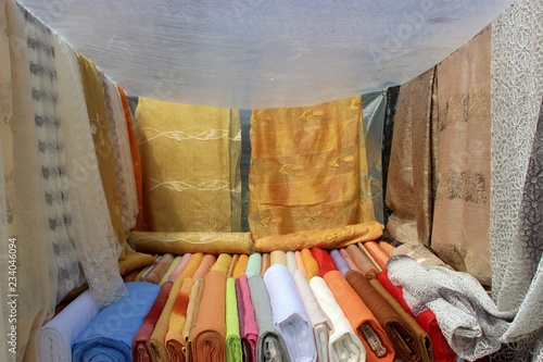 Fotobehang Indiërs Bed sheets blankets tulle curtains and fabrics for sale at a street market