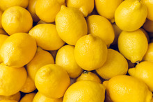 Ripe Yellow Lemons Close-up Ba...