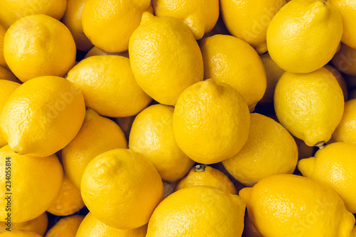Leinwand Poster Ripe Yellow Lemons Close-up Background Or Texture