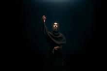 Medieval Monk Kneeling And Pra...