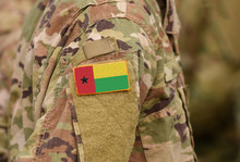 Guinea-Bissau Flag On Soldiers Arm. Guinea-Bissau Troops (collage)