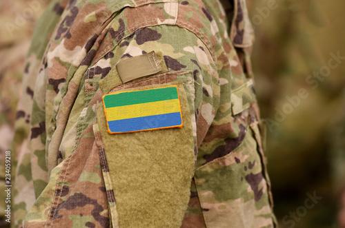 Fotografie, Obraz  Gabonese Republic flag on soldiers arm. Gabon troops (collage)