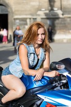 Red Hair Girl On Motobike. Photosessions Of A Motorcycle Suzuki Gsxr 2011. Blue With A White Bike With A Hat Helmet. Fall 2018, Lviv. Ukraine.