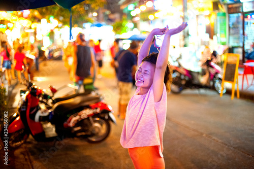 Japanese girl poses for pictures in Bangkok, Thailand Wallpaper Mural