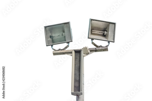 Foto op Canvas Licht, schaduw Electric spotlight pole on the street with blue cloudy sky background