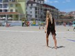 Attractive Sensual Beautiful Blonde Woman Walking on Sand Beach in See Through Transparent Black Dress