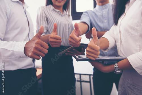 Fototapeta Team businessman shows thumb to appreciate each other. obraz