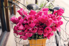 Pink Flowers On Front Bicycle Basket