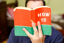 Person Holding And Readin From Book With Text Title, How To