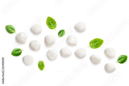 Composition with Mozzarella and  basil leaf isolated  on white background. Traditional Italian Mozzarella cheese balls close up. Top view