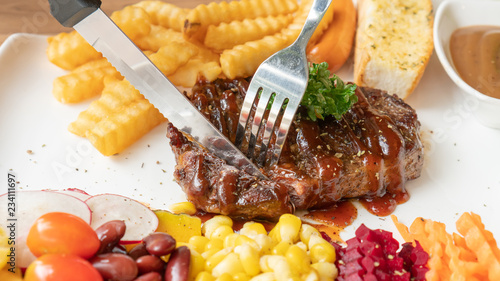 Cadres-photo bureau Plat cuisine Beefsteak, French fries, and vegetable on a white plate.