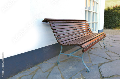 Enjoyable Wooden Bench In Front Of White Wall Of House Vintage Style Theyellowbook Wood Chair Design Ideas Theyellowbookinfo