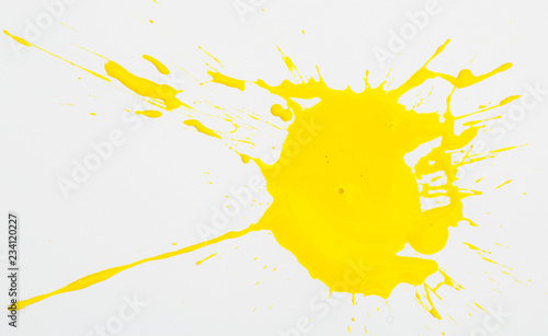 Fotografía  Yellow paint spots on paper, colorfull artistic image on white background