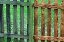 Two Parts Of Wooden Fence Befo...