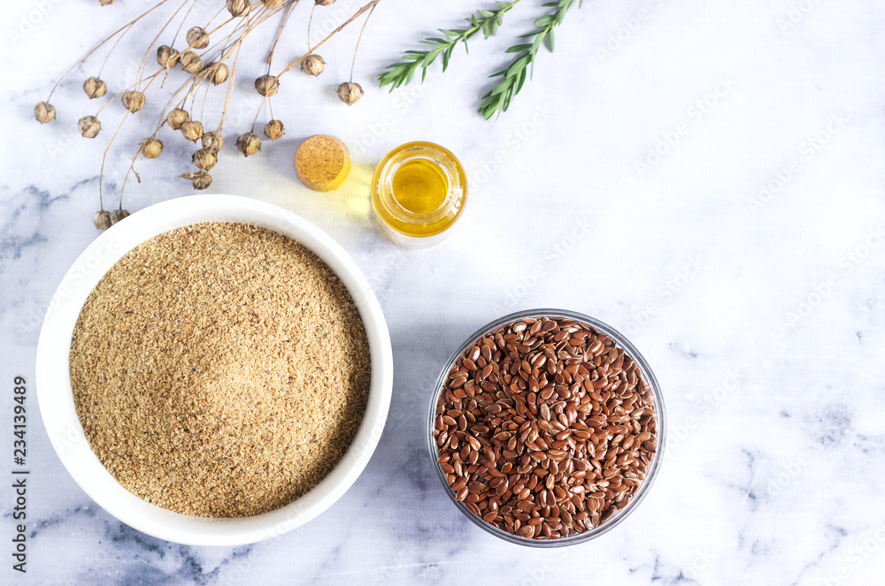 Fototapety, obrazy: Flax seeds, flax flour, oil with sprouts and flax seed boxes on a light background.