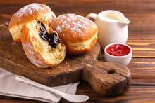 Tasty Sweet Sugary Chocolate Donuts With Raspberry Jam And Milk