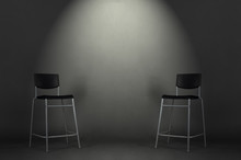 Two Black Chairs Isolated On Gray Background In The Studio With Copy Space. Job Interview Room.