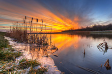 Winter Sunrise At The Lake In Poland