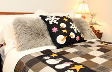 Cozy Bed Decorated With Snowma...