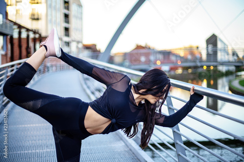 Fotografie, Obraz  Young British Lady making a sport in a sunny England day in Coventry, UK
