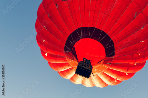 Spoed Fotobehang Luchtsport Colorful hot air balloon against the blue sky