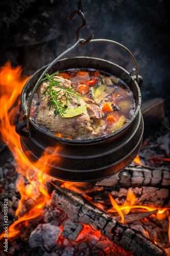 Hot and yummy hunter's stew with meat and carrots