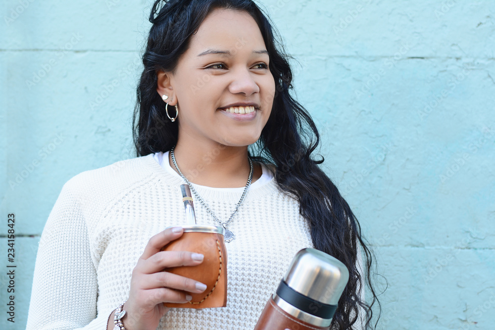 Fototapety, obrazy: Young latin woman drinking traditional yerba mate tea.