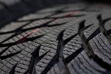 New Tread Of Winter European Tires. New Treads Winter Tires. With Grooves And Pumps Pumping Fluid From The Clutch Stain. Excellent Grip Quality. Background For Car Services And Tire Companies.