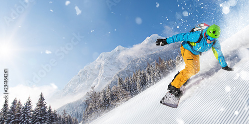 Man snowboarder riding on slope.
