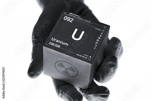Fotografia  Uranium cube in the hand of a scientist