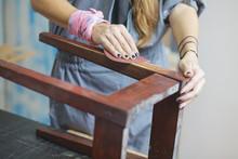 Detail Of Woman Restoring Furniture