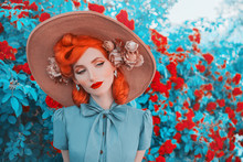 Valentines Day Background. Vintage Girl With Red Lips In Awesome Mint Dress. Summer Flowers Aroma. Woman Portrait. Awesome Redhead Model On Background Of Roses Bush. Summer Trend In Vintage Style