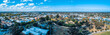 Aerial panorama of Melbourne suburbs on bright summer day