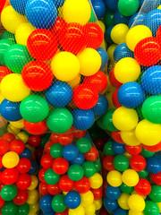 Fototapeta na wymiar Plastic colored balls in grid