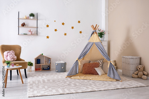 Cozy kids room interior with play tent and toys Fototapeta