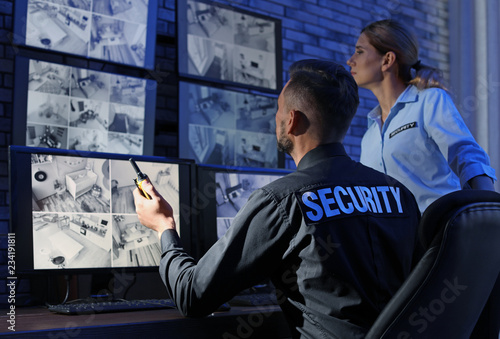 Fotografie, Obraz  Security guards monitoring modern CCTV cameras indoors
