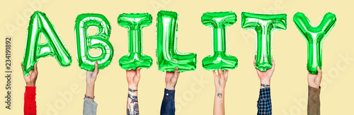 Photo Hands holding ability word in balloon letters