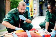 Paramedic Team Rescuing A Crit...